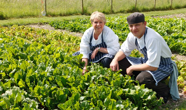 Barbara and head chef picking from home grown garden